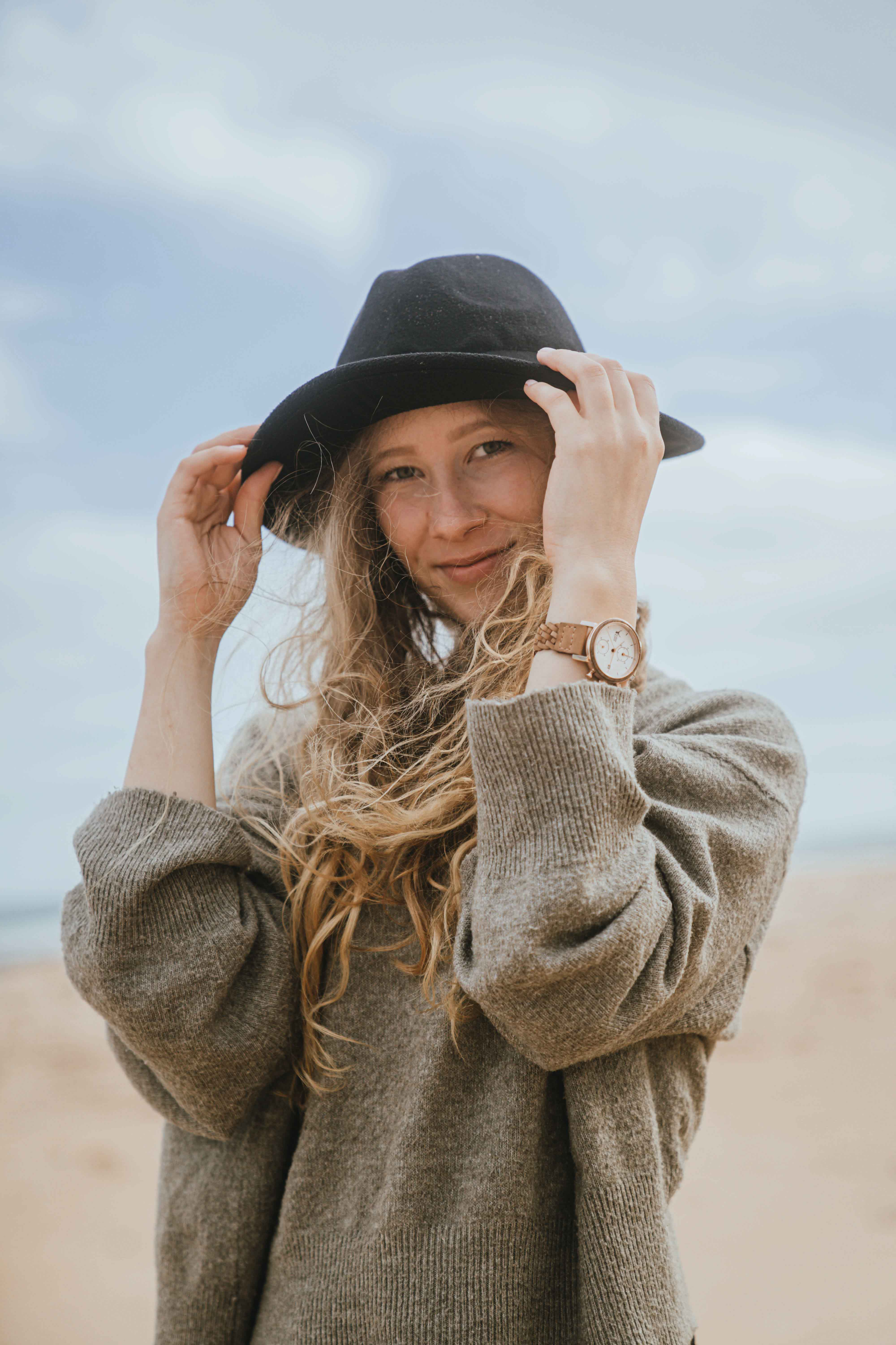 Girl with hat wearing Timber&Jack wrist watch