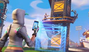 A Fortnite character holding a phone