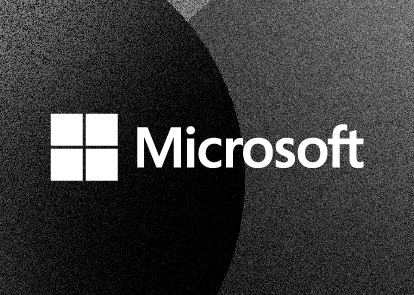 A black textured background with a white Microsoft logo