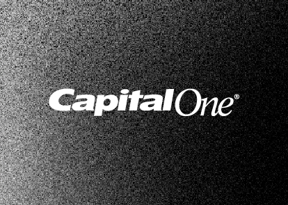 A black textured background with a white Capital One wordmark