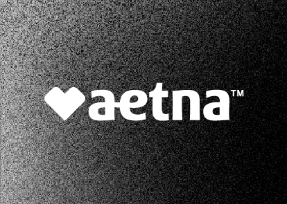 A black textured background with a white Aetna logo