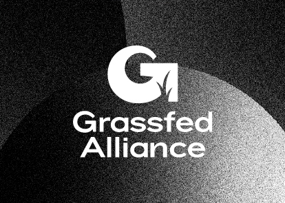 A black textured background with a white Grassfed Alliance logo