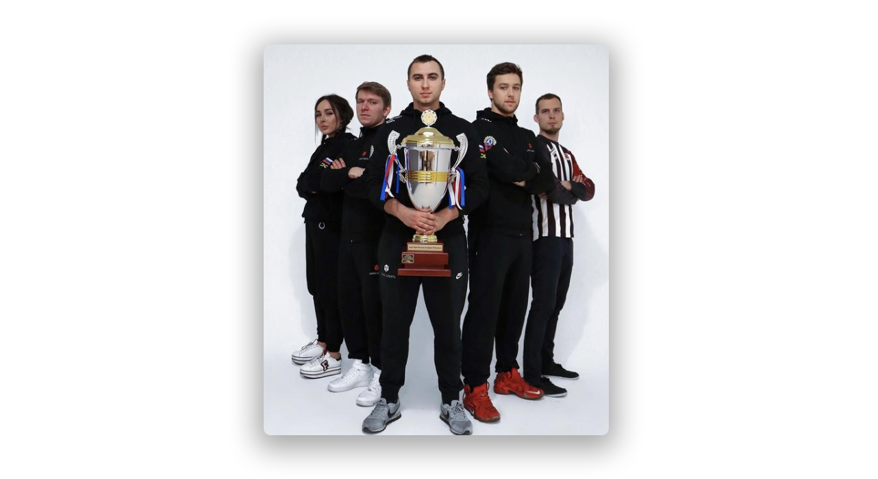 Drone esports holding trophy