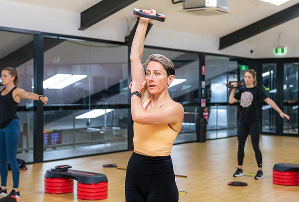 Woman lifting weight above her head in Camperdown Fitness BodyTone class