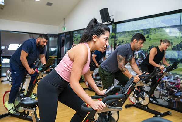 Group riding stationery bikes in Camperdown Fitness Spin class