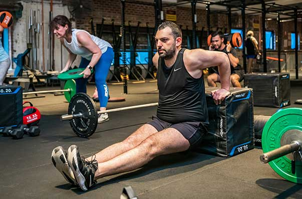 Man doing dips in Camperdown Fitness Xtrainer class