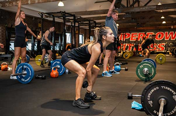 Women lifting weights in Camperdown Fitness Total Body Strength class