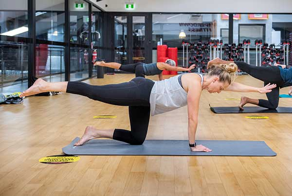 Women stretching her leg out horizontally in Camperdown Fitness Pilates class