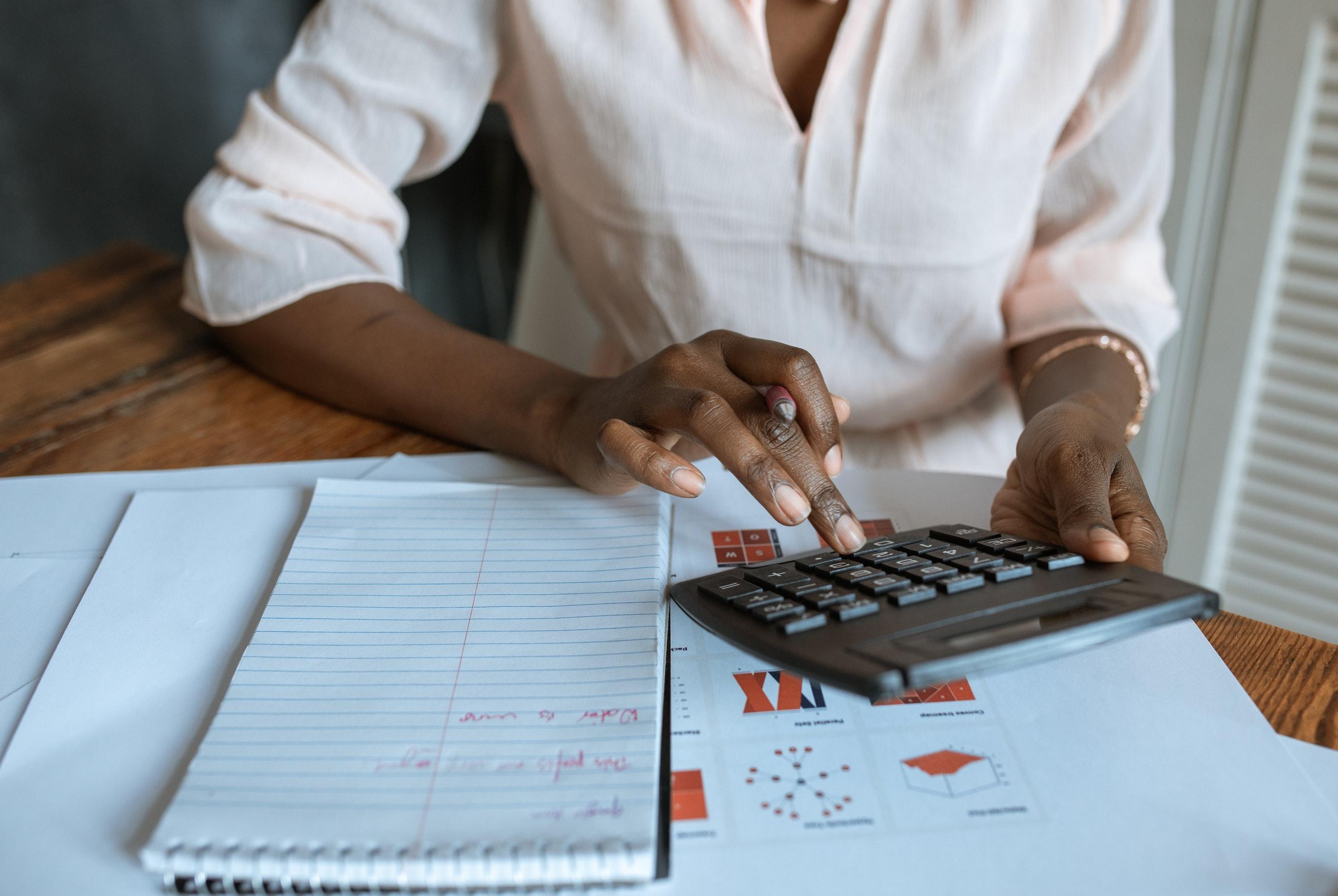 entrepreneur with a calculator