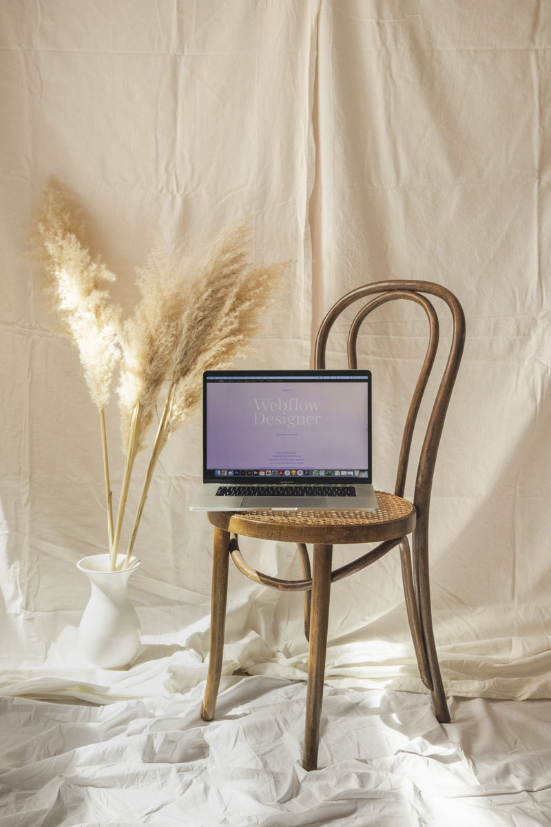 Open laptop on a chair by Alexandra Linortner