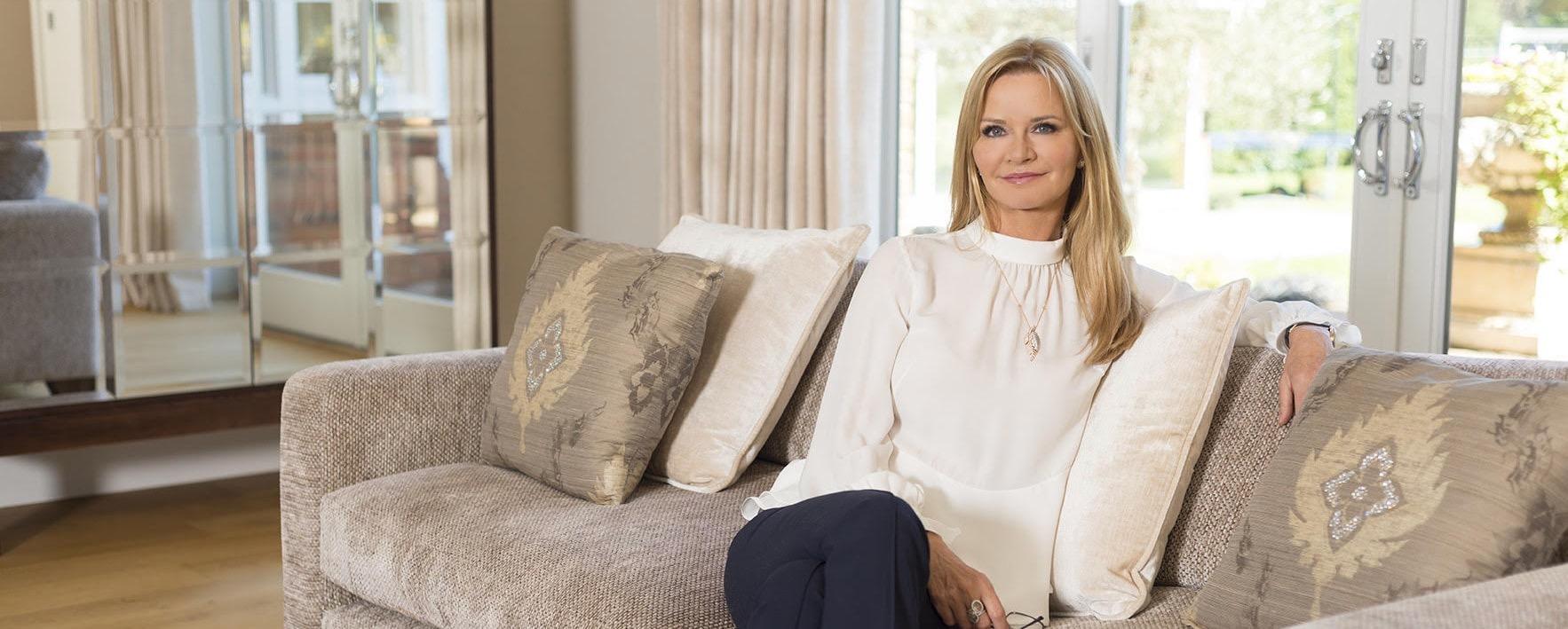 Elizabeth hammond sitting on sofa