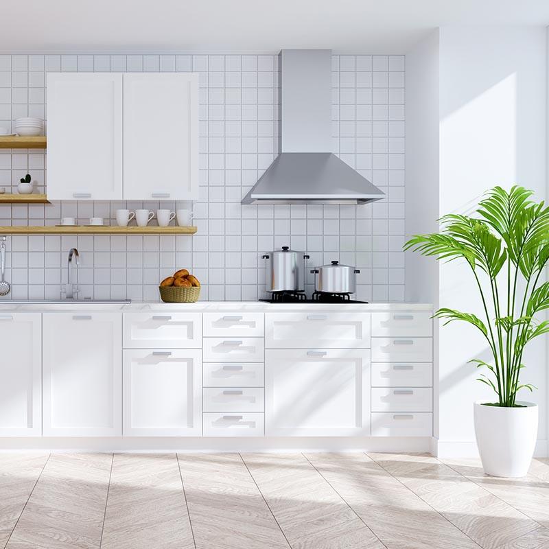 White Wall tiles, Stainless Steel extractor fan, Herringbone Limestone, Chrome Swivel tap.
