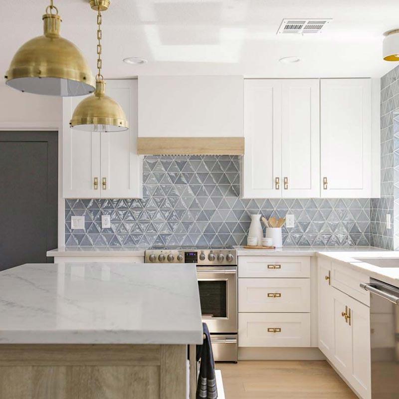 Statuario Marble tiles, Limed Oak Vinyl, Grey and Blue Triangular Tile, Prism Tile, White grout, Backsplash.
