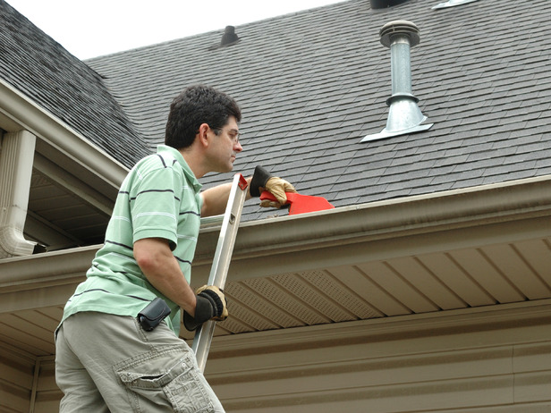 20-Tips-for-Spring-Cleaning-cleaning-out-gutters