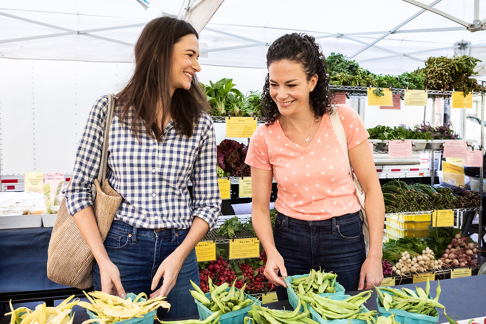 Christine and April laughing at the farmer's market
