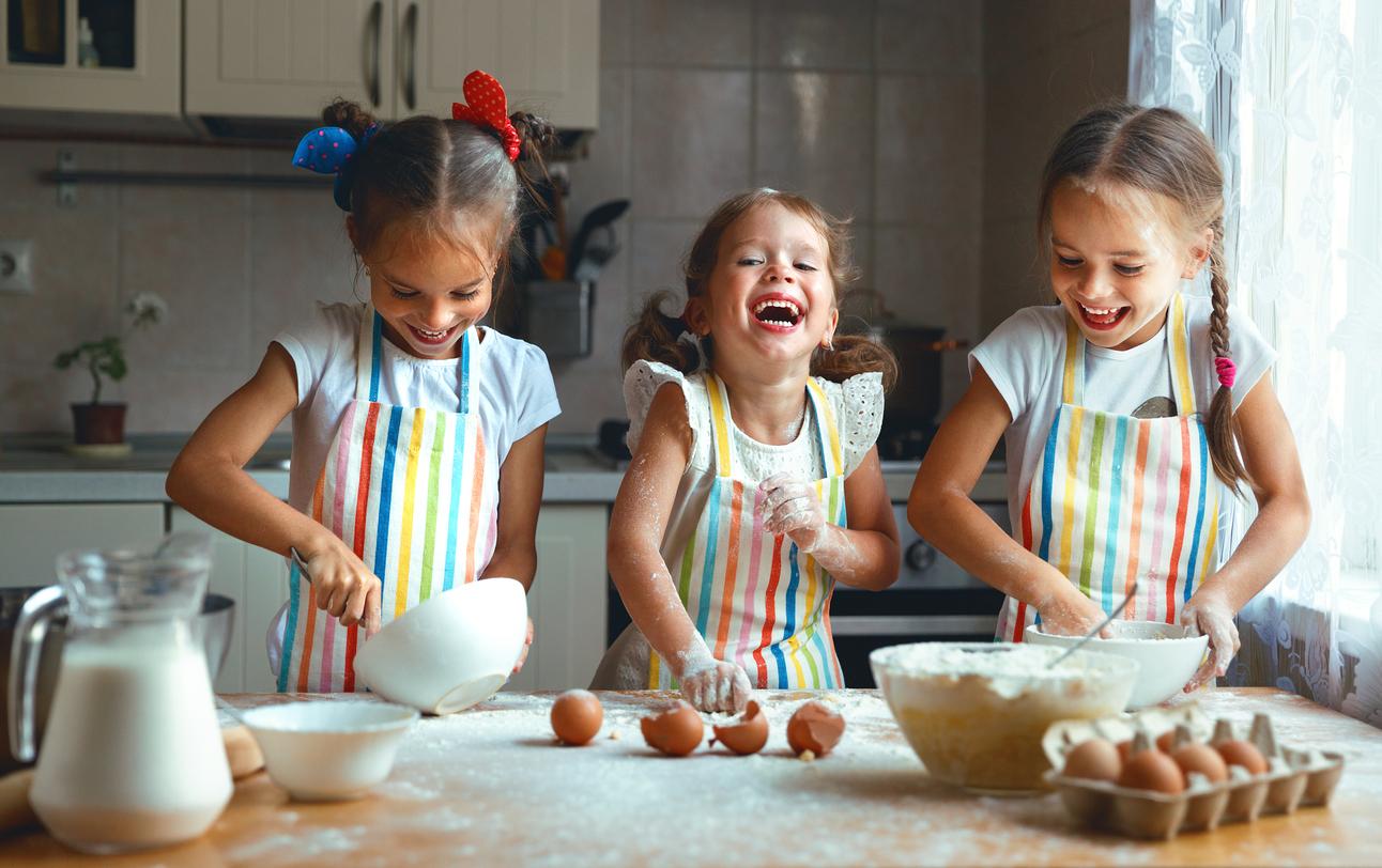 3 girls laughing and baking