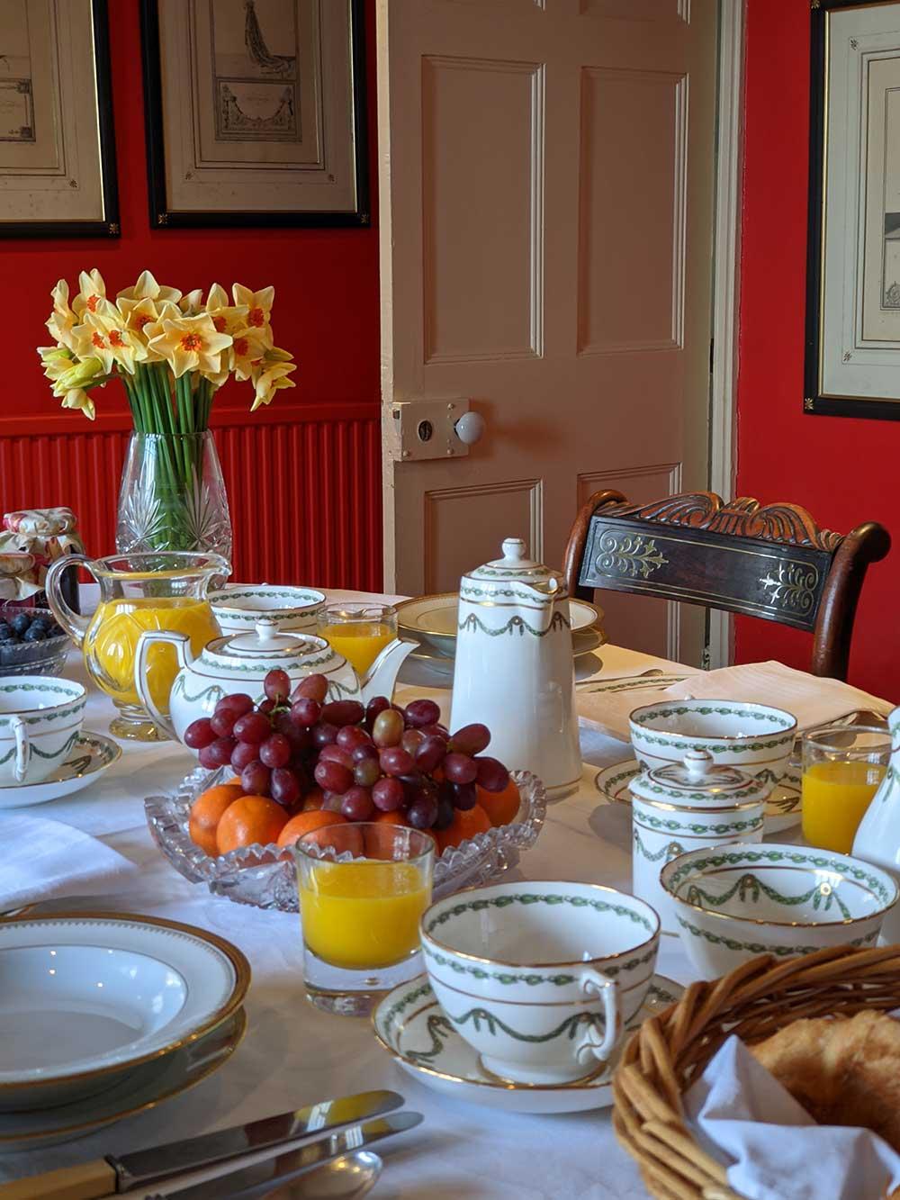 Breakfast of croissants, orange juice and fruit