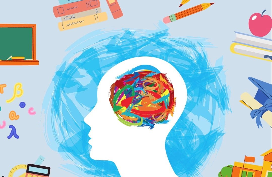 Person's head full of scribbles surrounded by school supplies
