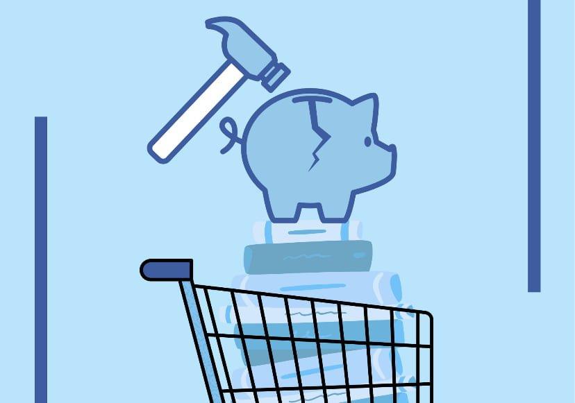 Hammer hitting piggy bank over a cart of books