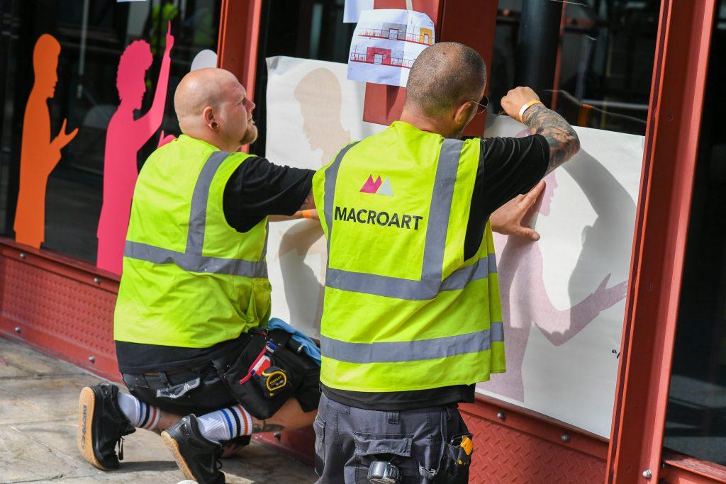 Macroart installers applying window vinyl graphics