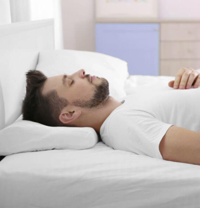 A man relaxing on a bed