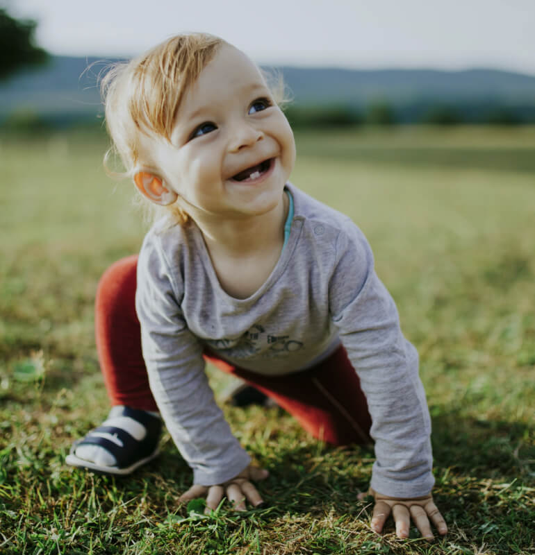 A happy baby playing