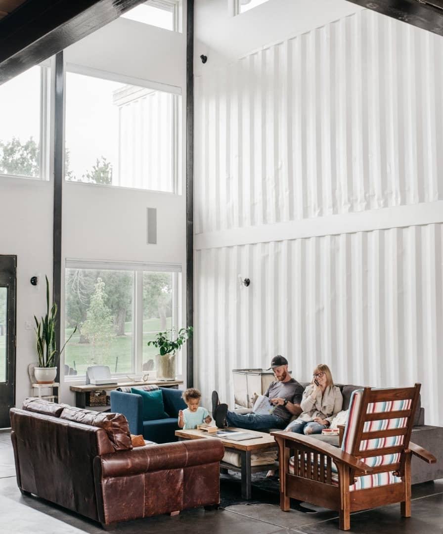 A family relaxing in a sea container house