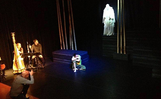 doriene marselje to the left and old man in white robe performer on the right.