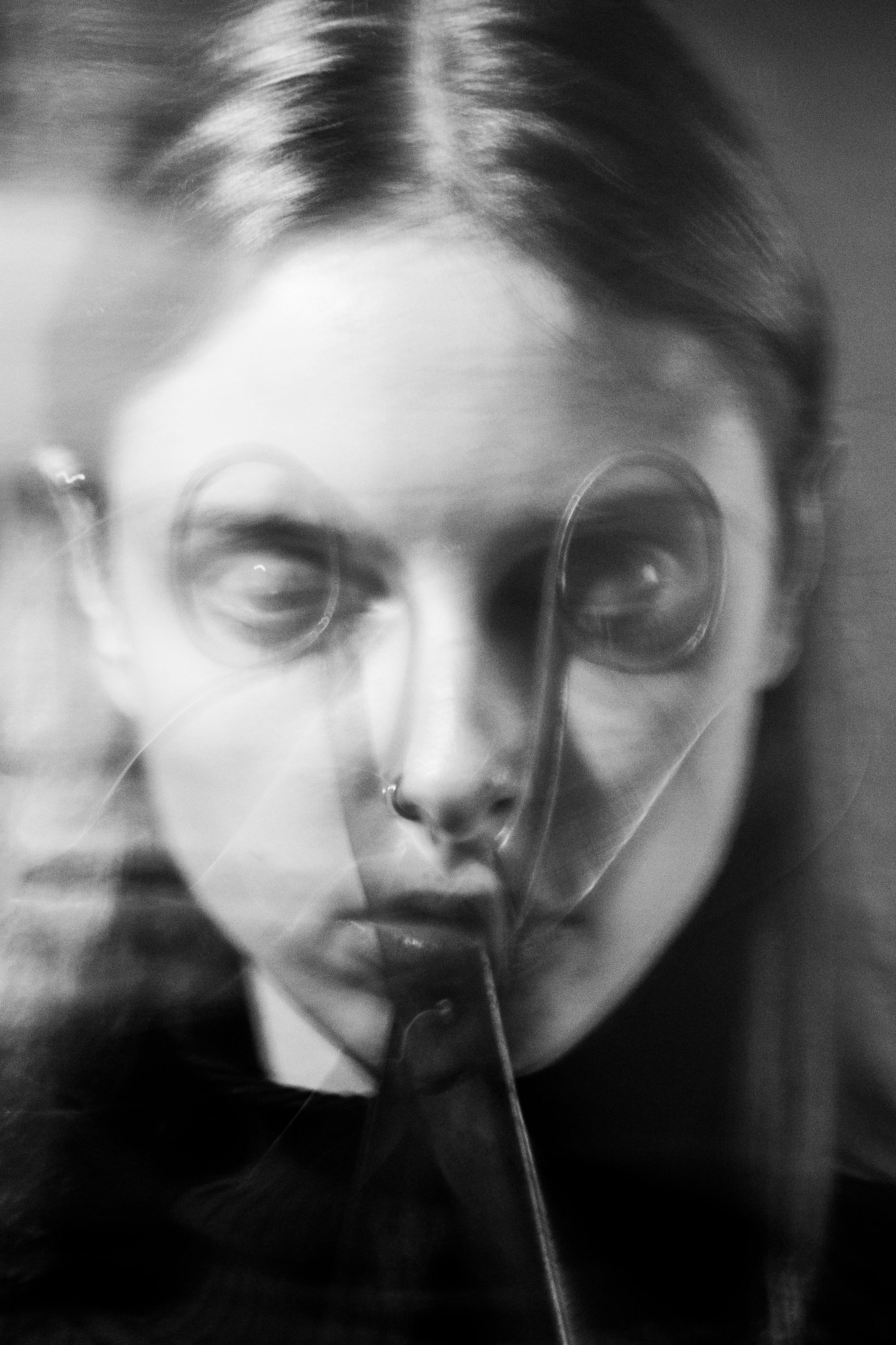 Experimental black-and-white portrait of Larissa Matheus (perfomer, artist, publisher, designer and internationally published model) shot in Fotografie Berlin e.V. studio (Berlin, Neukölln)