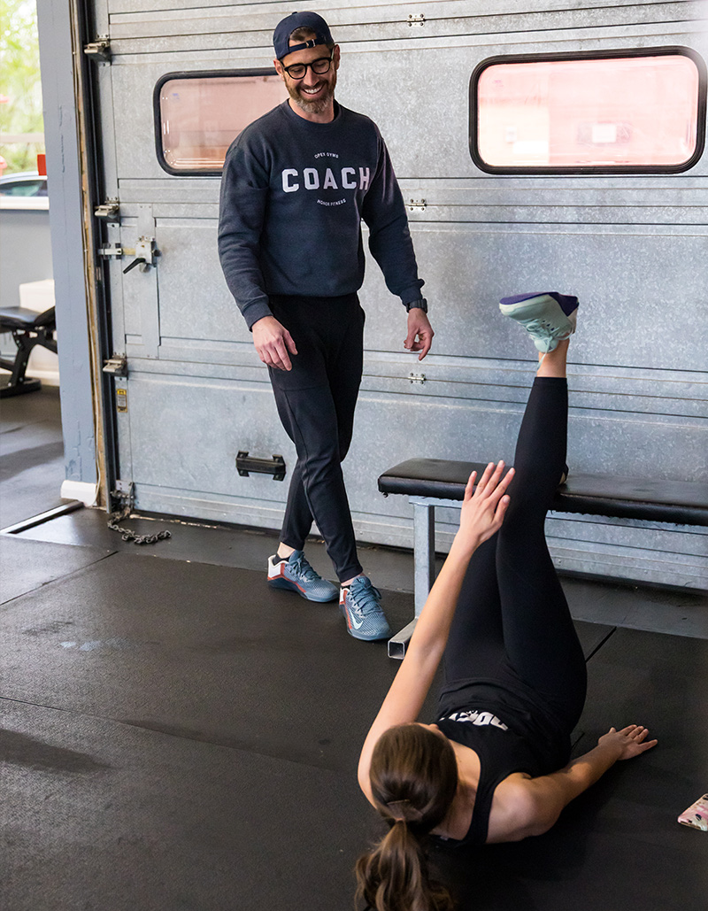 Personal Trainer Glen coaching a client through their workout