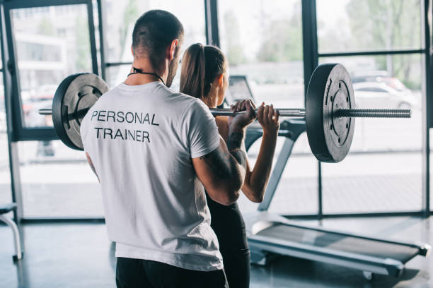 A classic personal trainer training a client
