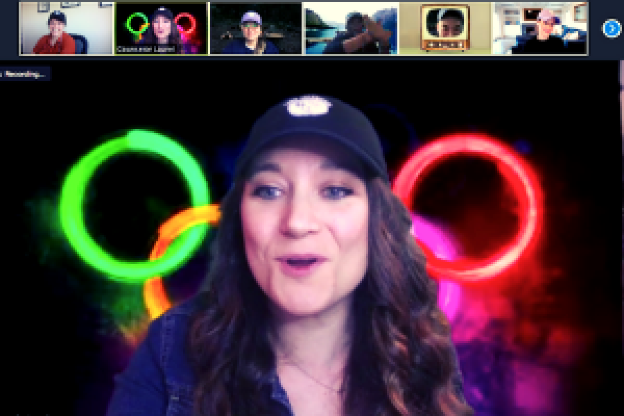 people on zoom, with one main leader with olympic rings in the background