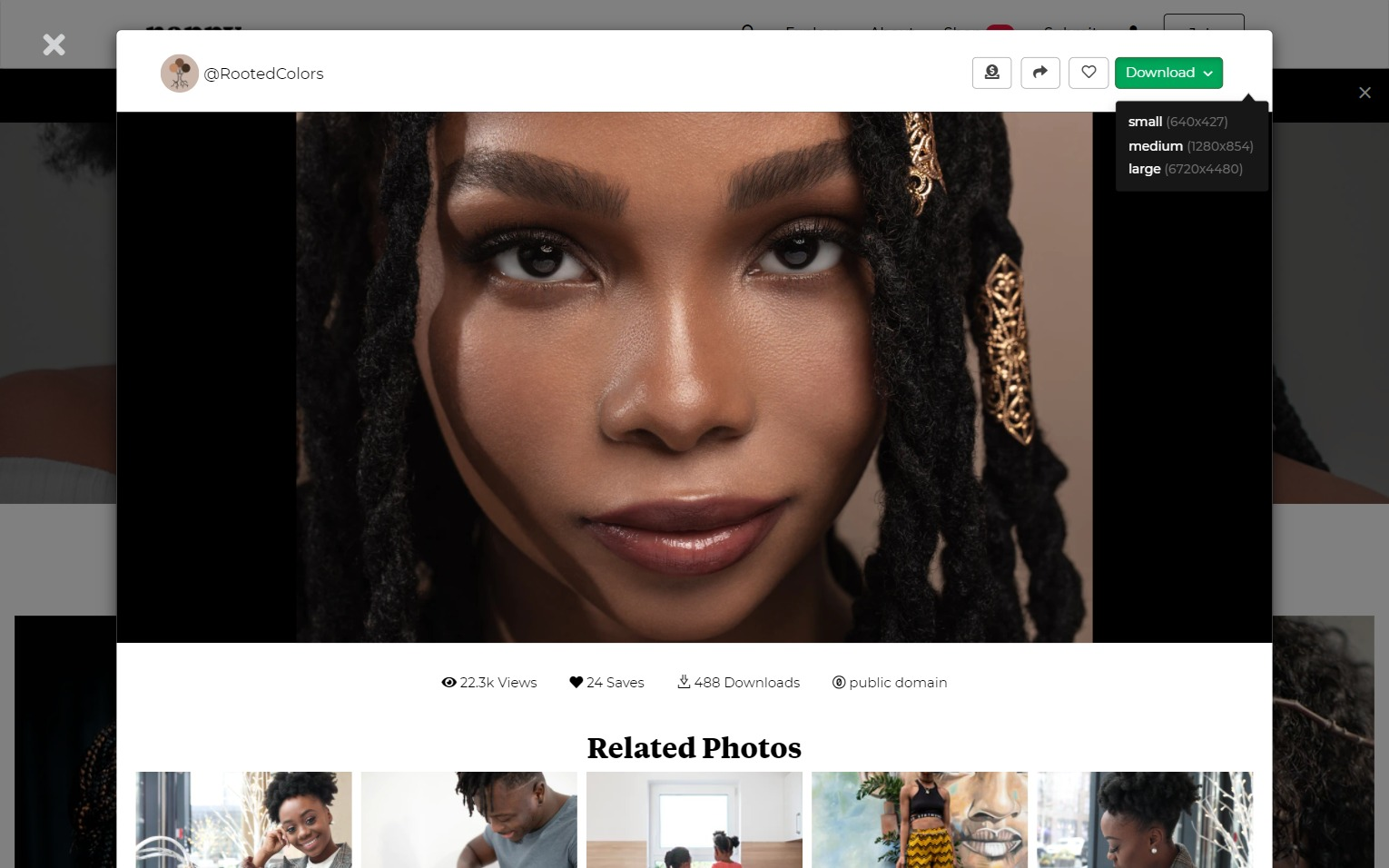 Nappy stock photos interface featuring BIPOC woman smiling at camera