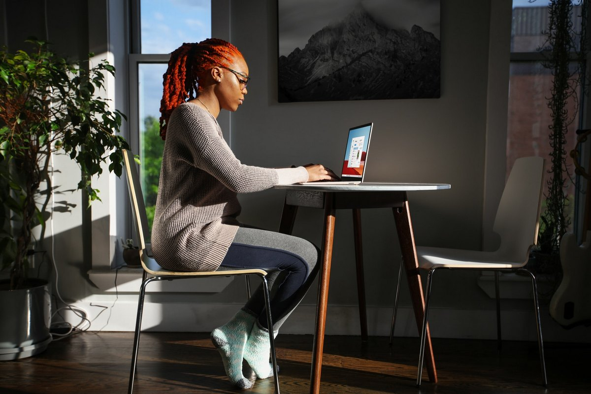 Young woman using a surface laptop
