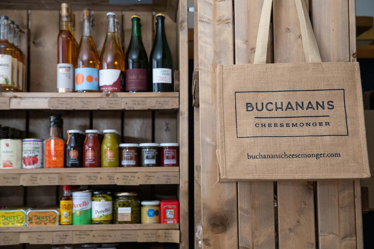 Bottled sauces and Buchanans shopping bag