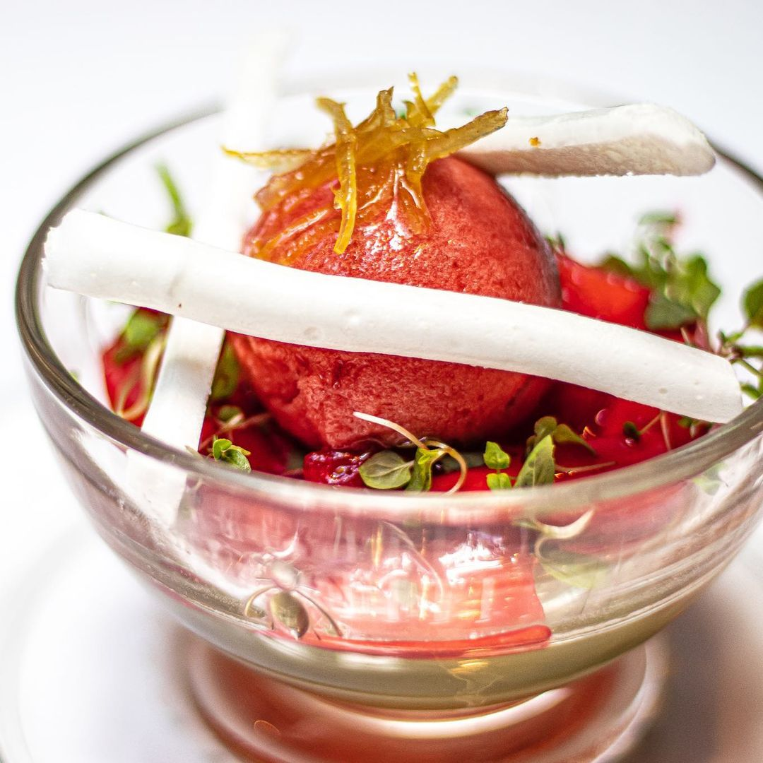 Elderflower and prosecco jelly with dressed English strawberries, strawberry sorbet and meringues