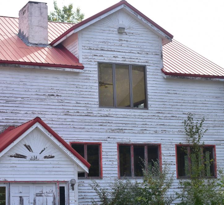 Dilapidated white hotel