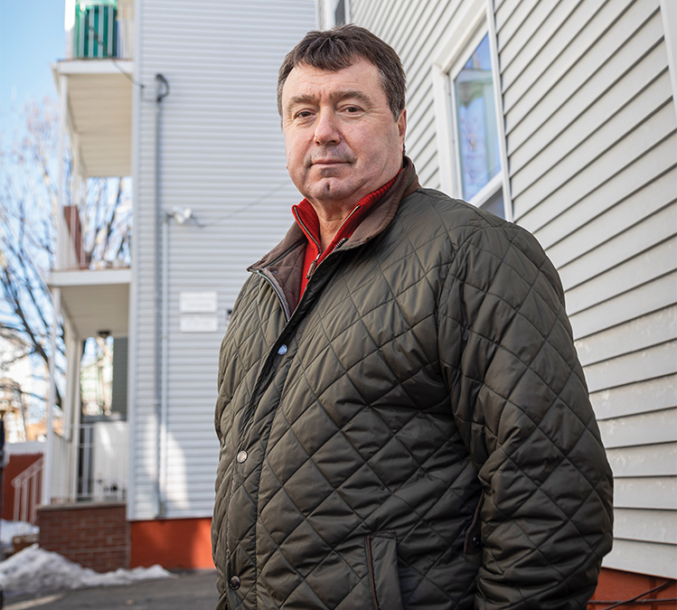 Photo of Mark DeJoie outside of affordable housing unit
