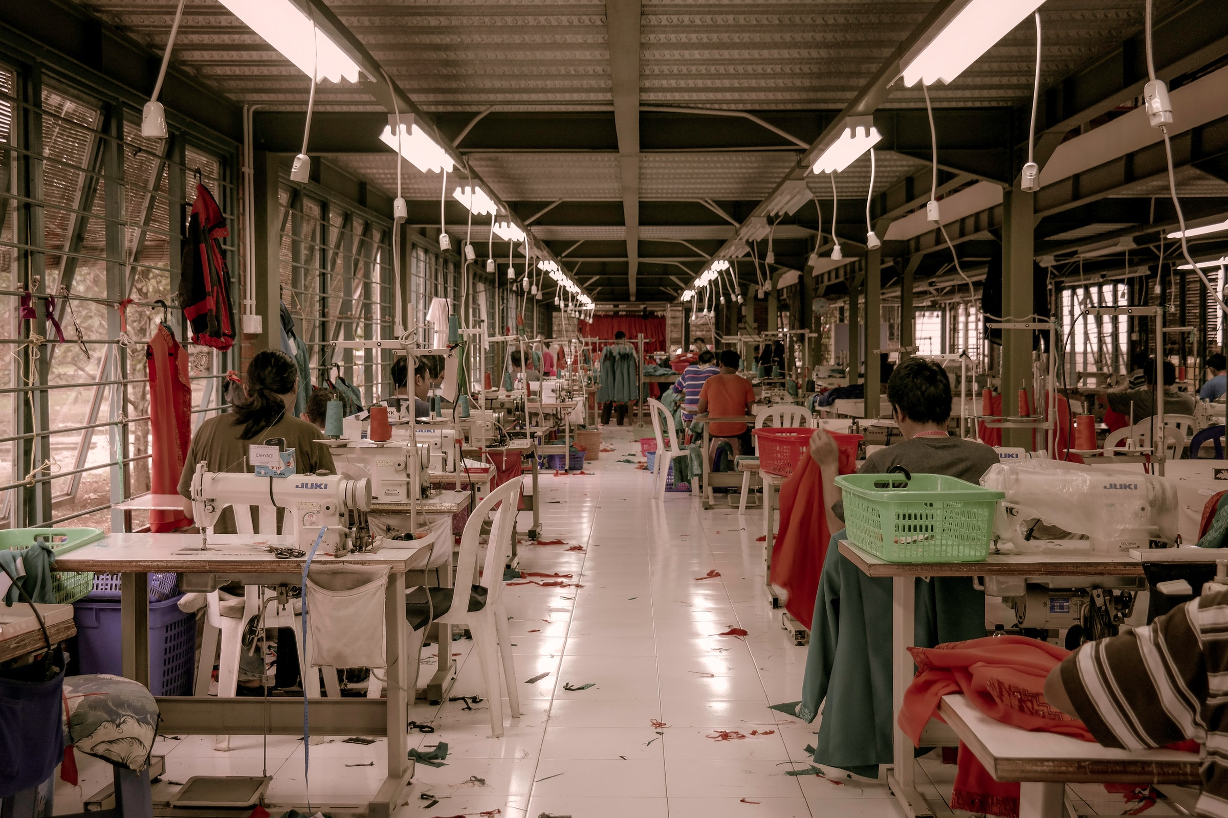 People working in a fashion factory making clothes