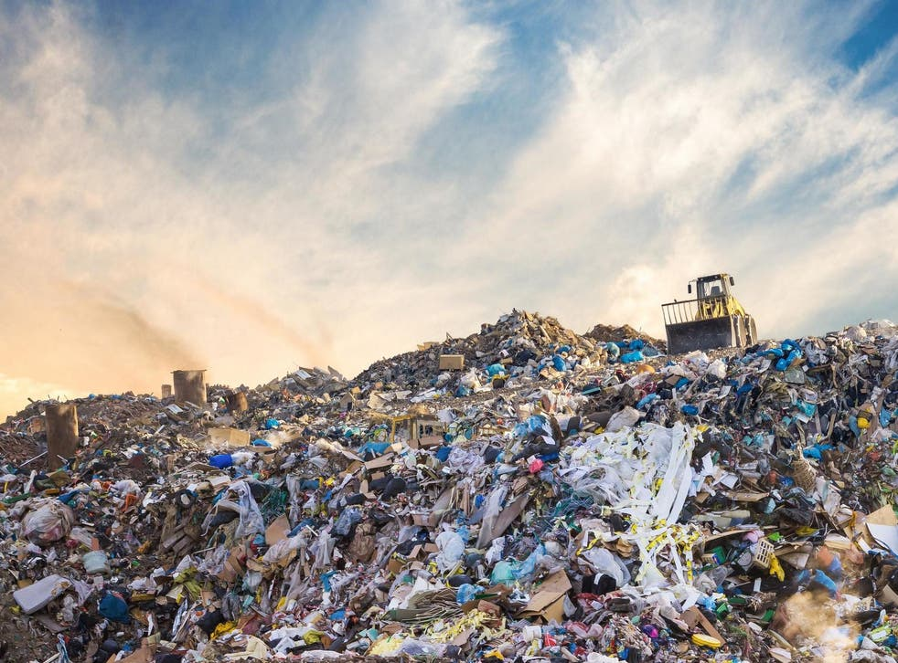 Textile waste and other debris disposed of in a landfill site