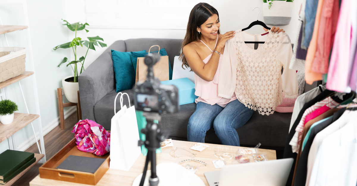 Woman alking about clothing while doing a live video for her fashion blog on social media