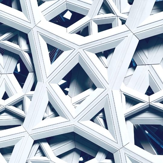 Managed network services. Modern architecture and a mix of blue and white.