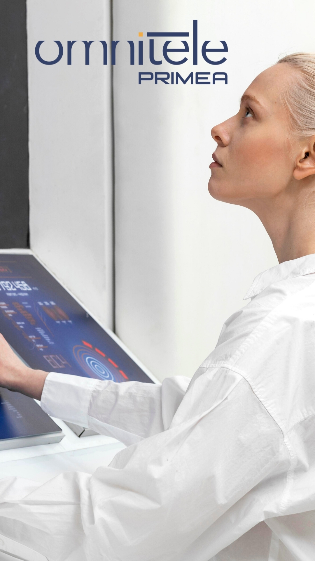 Blonde woman working on digital monitors. White and blue colors