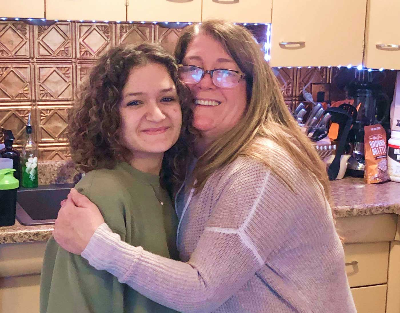 My daughter and I hugging in the kitchen