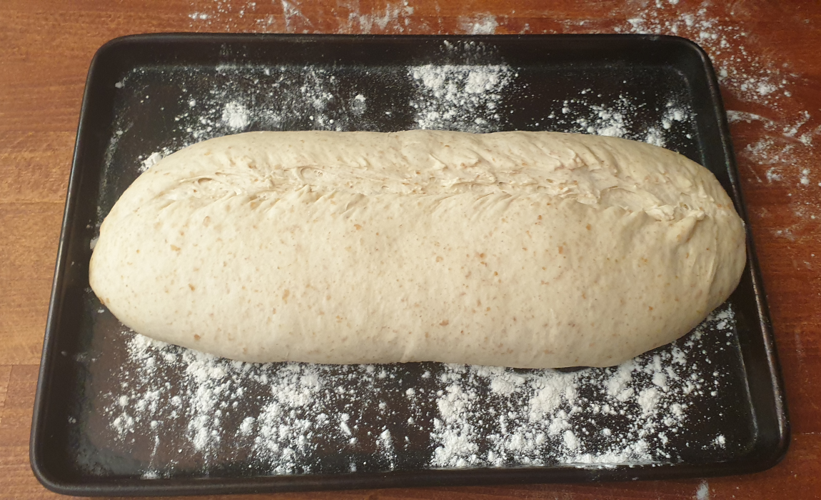 My loaf scored and ready to go in the oven.