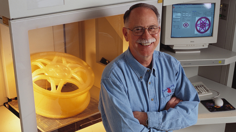 Chuck Hull stood in front of a 3D printed wheel hub made using the technology he invented