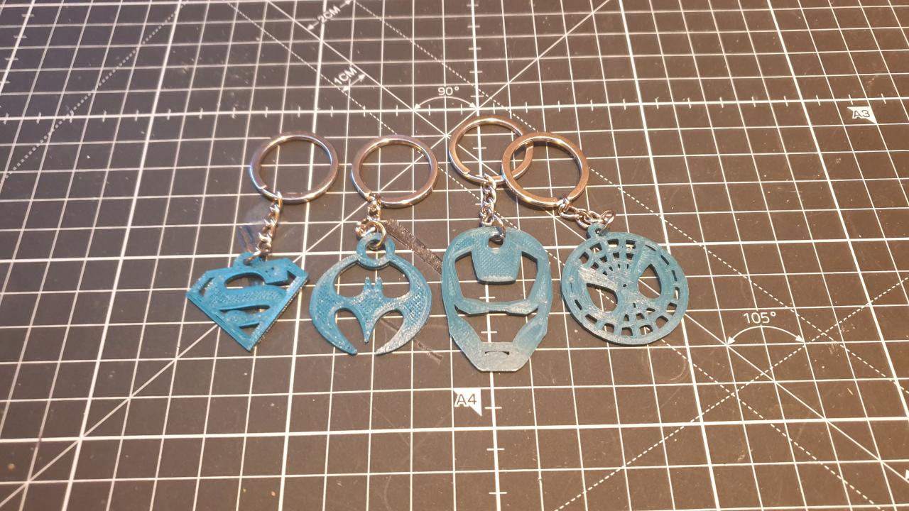 The four superhero keychains made by FORMBYTE