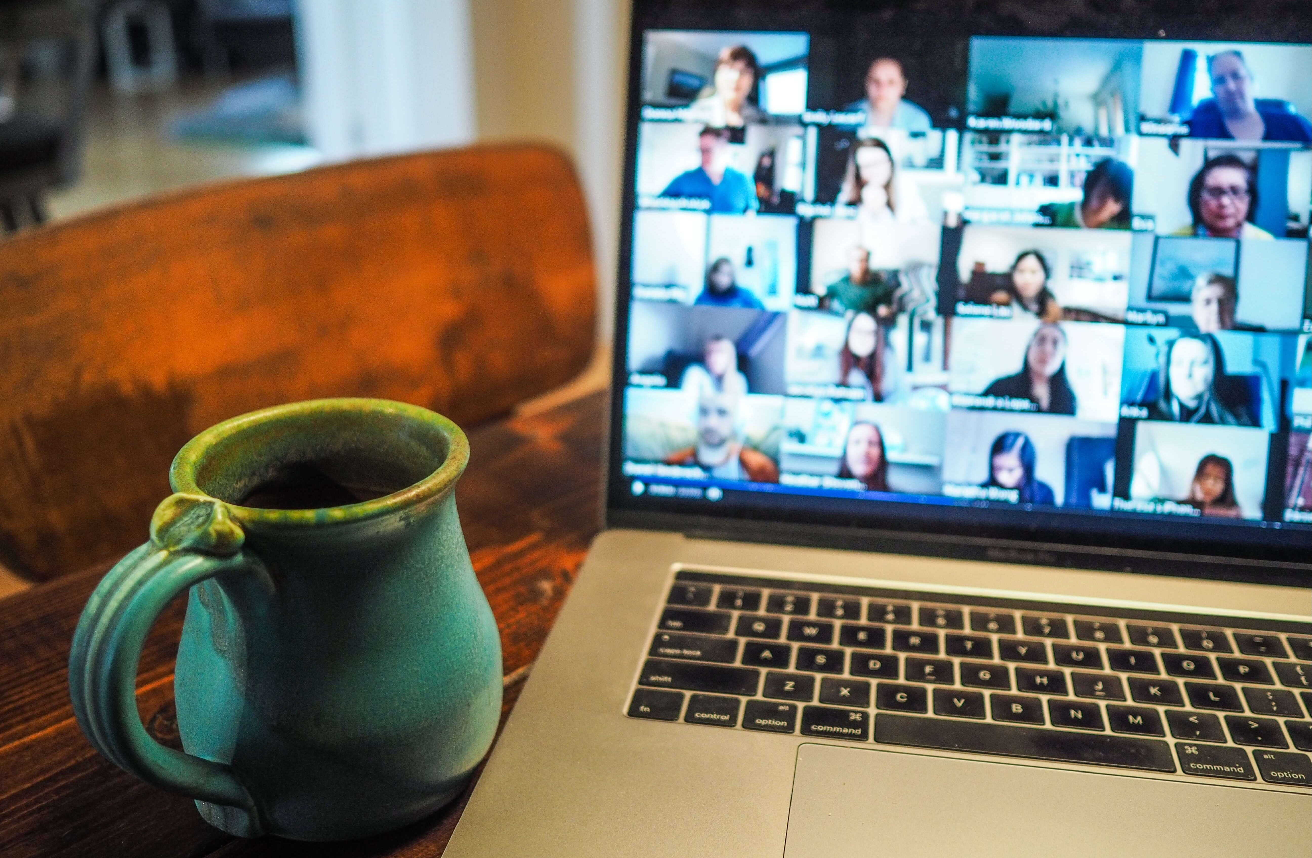 picture of people on zoom with coffee mug