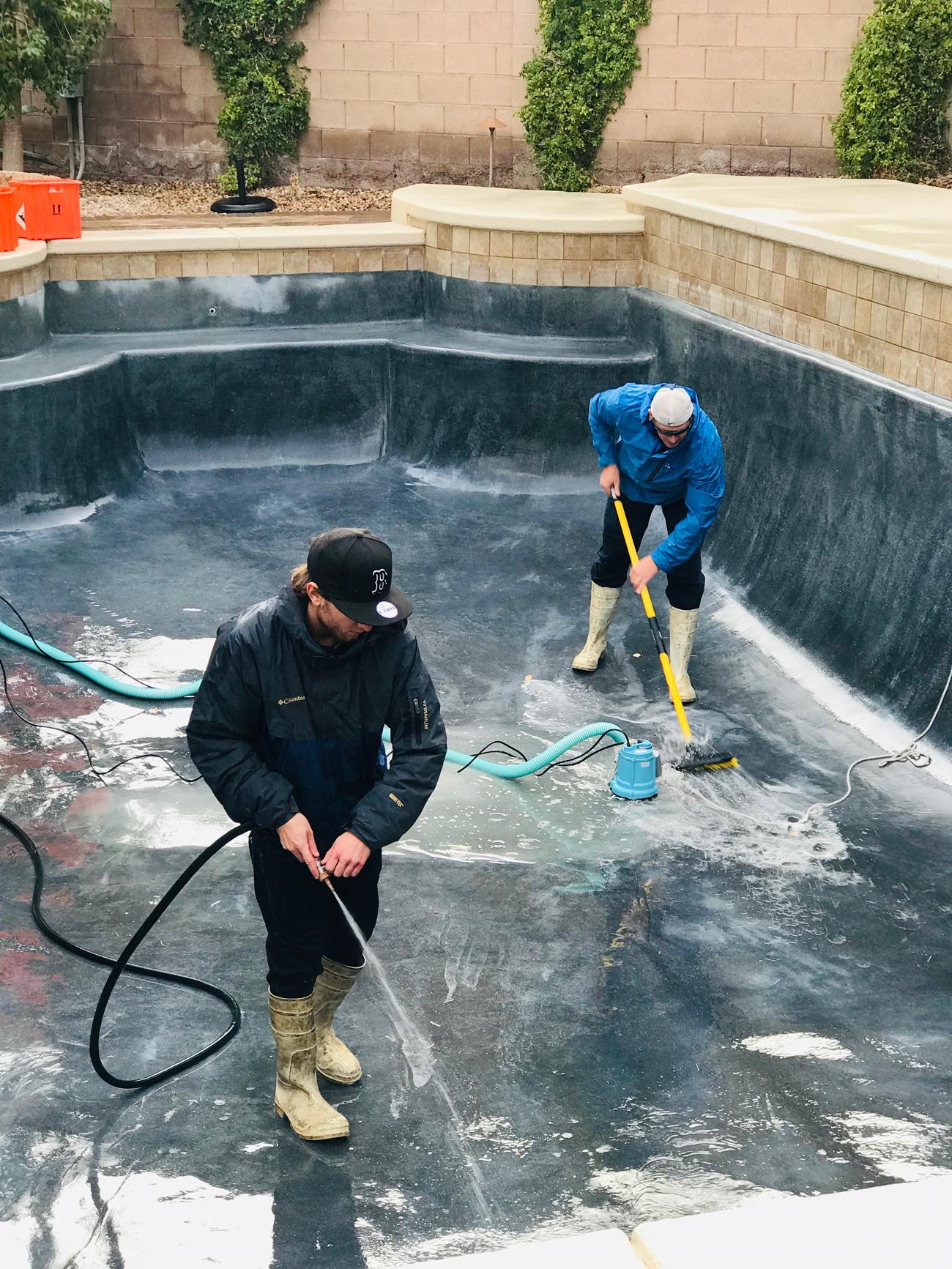 Acid wash inside drained pool
