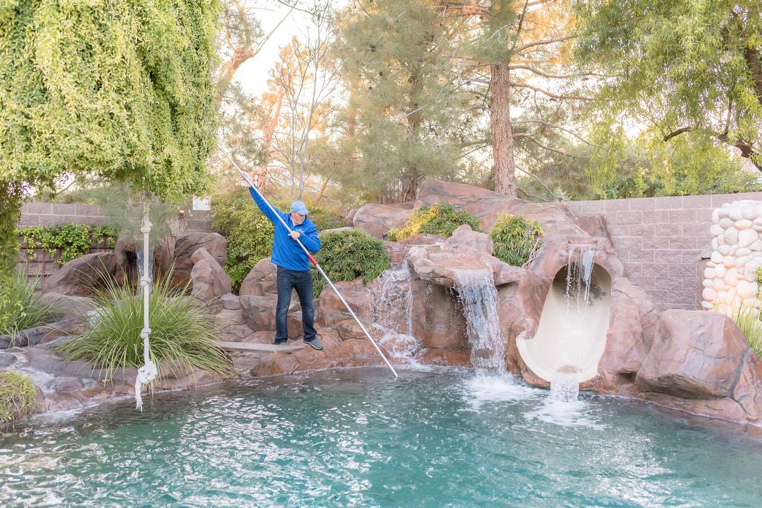 Pool being cleaned by Clean Living Pool & Spa employee